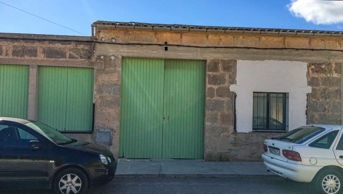 garage-mit-grundstück-garten-immobilie-cas-concos