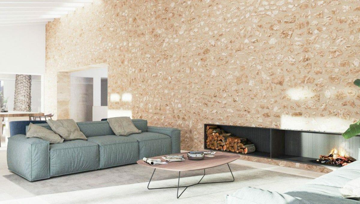 Wohnzimmer mit Steinwand un Kamin